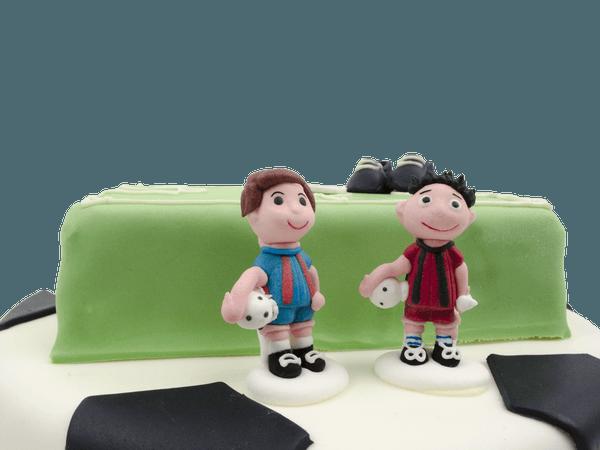 Voetballers op voetbal taart
