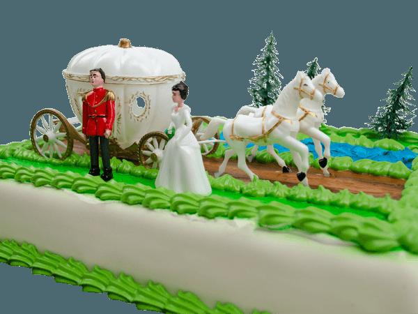 Assepoester en de koets op een taart
